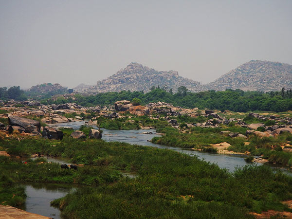 Things to do in Hampi - take a quick dip in the might Tungabhadra River